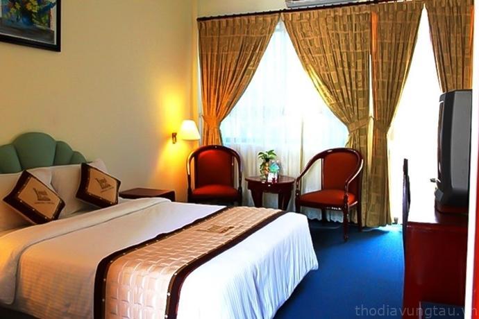 phòng ngủ ở Royal Hotel