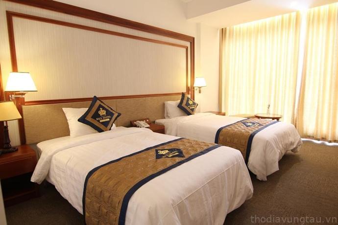 phòng ngủ ở Rex Hotel